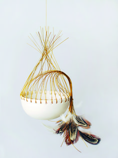 Porcelain, feathers and copper wire vessel by Lisa Tilse.