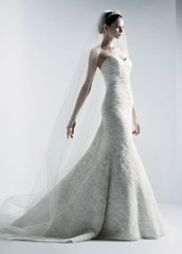Strapless sweetheart beaded lace trumpet with shirred tulle bodice. Sweep train.