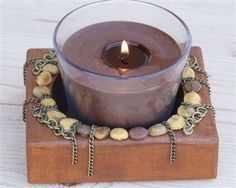 Beautiful sugar mold made into a candle holder - love the beads and chains!
