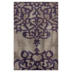 Wool and art silk rug with a scrolling oversized damask silhouette. Hand-knotted in India.   Product: RugConstruction Material: Wool and viscoseColor: Cement and purpleFeatures:  Made in IndiaHand-knotted Note: Please be aware that actual colors may vary from those shown on your screen. Accent rugs may also not show the entire pattern that the corresponding area rugs have.Cleaning and Care: These rugs can be spot treated with a mild detergent and water. Professional cleaning is recommended if…