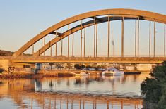 The Nico Malan Bridge spanning the Kowie River on the in Port Alfred, Eastern Cape, South Africa, was built in 1972 as part of the construction of the between Port Elizabeth and East London Between The Oceans, Twin River, Port Elizabeth, Game Reserve, Sunset Pictures, Small Boats, Places Of Interest, Sunshine Coast, Sydney Harbour Bridge