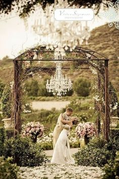 I always imagine a wedding ceremony in the woods surrounded by flowers and plants, with a chandelier hanging and aisle full with rose petals via Inweddingdress.com.  Re-pin if you like. #wedding