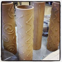 Use hot glue on empty school paper towel rolls (thick and heavy rolls) to create rollers for clay. !