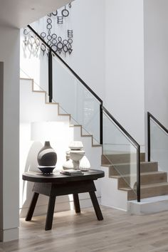 Disc Interiors - Interior Designer - Los Angeles - Contemporary - Modern - Rustic - Foyer - Staircase - Neutrals - Wood Floors - Glass Rail - Display Table - Vases - Decor - Accessory - Display