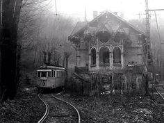 """This is eerie looking. A haunting crackling voice comes across the ghostly speaker's echoing out the broken windows and down the open boarding deck of the train station that's been abandoned for well over 55 years.""""all aboard for Capital City. Abandoned Buildings, Abandoned Mansions, Old Buildings, Abandoned Places, Abandoned Detroit, Spooky Places, Haunted Places, Abandoned Train Station, Train Tracks"""