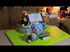 """Quick how to video of Thom making a Noah's Ark Diaper cake. Hope you like it! Thanks for watching!      Noah's Ark Diaper Cake (How To Make) """"Diaper Cake"""" Noah Ark Boat """"Nappy Cake"""" """"Baby Shower"""" Gift"""