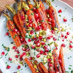 Tired of honey carrots? Try this delicious alternative out! Crispy, maple roasted carrots in tahini sauce with pomegranate and pistachios. Be sure to use our SoCo's tahini for an extra tasty, nutty kick. Dinner Side Dishes, Dinner Sides, Potluck Dishes, Mango Salsa, Thanksgiving Recipes, Holiday Recipes, Christmas Recipes, Christmas Meals, Christmas Brunch