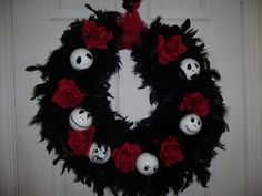Love this...Nightmare Before Christmas wreath!  Wreath form wrapped with black feather boa, some roses, and white ornaments/ping pong balls with Jack's face drawn on.