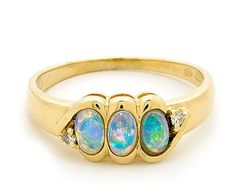 Having three stones is better than one stone.  The Opals Australia design team has selected three fantastic stones sourced from the quality opals mines surrounding Coober Pedy South Australia. Using 18k Yellow Gold and round brilliant cut diamonds our team has designed a fashionable and current ring setting.  This would make great present for any individual who has a passion for jewellery designs. #opalsaustralia