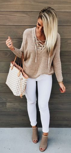 Love the camel/tan color sweater with white jeans!