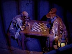 Pirates Of The Caribbean Ride Disney World | chess as visitors wait in line for the Pirates of the Caribbean ride ...