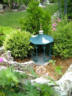 """Love the shrubs surrounding the miniature gazebo - these little conifers make good """"trees"""" for a fairy garden"""