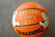 father's day hand print ball... would do a football for dathan since he hates basketball ;)