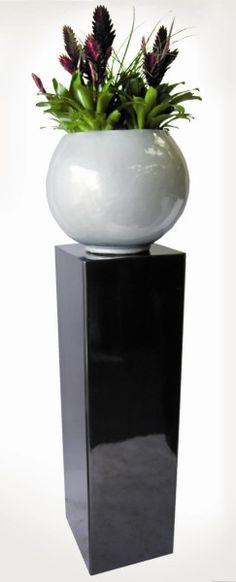 Chicago pedestal in polished metallic black and Oslo bowl in polished metallic silver