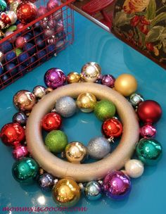 How to Make a Christmas Ornament Wreath. Honeslty the easiest thing to do and great Christmas gift ideas for parents and grandparents! You can't go wrong!!