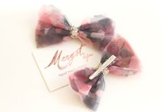 A personal favorite from my Etsy shop https://www.etsy.com/listing/249787736/bow-clips-set-pretty-pink-camouflage
