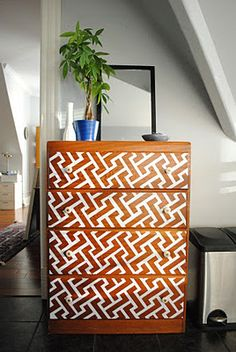 painting a pattern on a set of drawers
