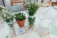 Jars Flowers Succulents Daisies Rural Handfasting Village Hall Wedding http://www.annapumerphotography.com/