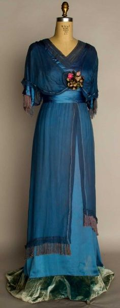 Silk evening gown, 1912 - Powder blue silk satin w/ blue chiffon overdress, ribbon rosette trim, trained skirt w/ velvet hem band.