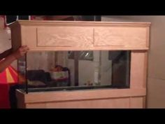 New 75 gallon peninsula coral reef fish tank stand build - YouTube  Sliding canopy lid... very cool idea!