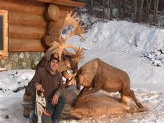 Fighting Caribou Chainsaw Carving By Jordan Anderson - YouTube