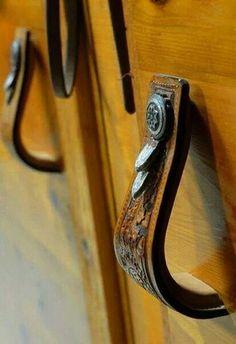 Good idea. Use old, unused stirrups as door handles.