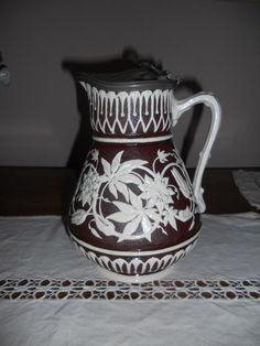 """Unknown manufacturer; possibly Copeland. Stoneware, white with brown ground. Indistinct British registered design """"diamond"""" mark."""