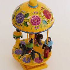 Mexican folk art toys reflect the artisan's humor and love of the delightful object. These wood, gourd and lacquer carousels were handmade in Olinala, Guerrero and are absolutely delightful. Smiles are popping out all over. They rotate in a circle but they are not intended for children. But they absolutely