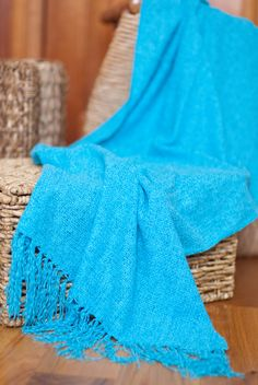 Tissue-Weight Chenille Scarf.  Doubles as a wrap.  Its vibrant hue and classic weave instantly update any outfit.
