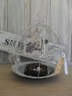 recycled pieces of wire and aviary wire mesh,  altered bird ephemera book art used for a perching swing, and nest