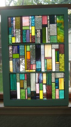 Vintage Wooden Window with stained glass brightly colored strips. $333.00, via Etsy.