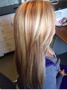 Blonde hair with red lowlights.
