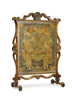 A RÉGENCE CARVED WALNUT FIRE SCREEN CIRCA 1715 upholstered à châssis with Louis XIV petit-point wool and silk needlework panel, French, early 18th century. height 47 1/4 in.; width 33 1/4 in.