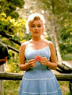 Love the pale blue polka dot with white piping between the ruffles, cute idea for little girls peasant dress pattern I have. Oh and this is Marilyn, 1957.