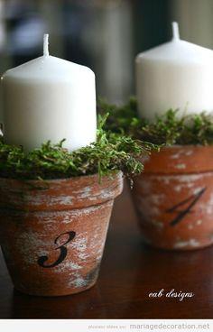 Bougie dans un pot de fleurs, número centre table mariage