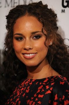 Alicia Keys often lets her natural curls free.