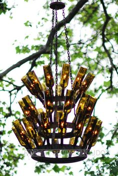 Vintage Series: Decorating with French Bottle Drying Racks Bottle Rack Chandelier Vintage Series: De Wine Bottle Chandelier, Diy Chandelier, Bottle Lights, Vintage Chandelier, Chandeliers, Wine Craft, Wine Bottle Crafts, Wine Bottles, Amber Bottles