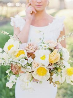 The All-White Farmhouse Venue That Will Have Vineyard Brides Weak in the Knees I love this sunshine yellow, white, and creamy bouquet! Spring Wedding Bouquets, Yellow Wedding Flowers, Spring Bouquet, Bride Bouquets, Bridal Flowers, Flower Bouquet Wedding, Floral Wedding, Summer Wedding, Dream Wedding