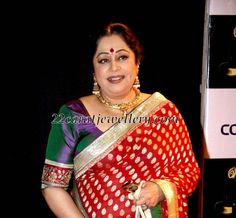 Kiron Kher in red benarasi with Rajasthani hasli neck piece  from Amrapali. Description by Pinner Mahua Roy Chowdhury.