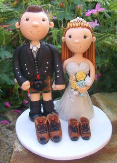 Like this idea for topper with the walking boots as we're having munros we have climbed as table names...