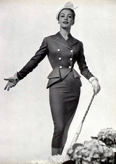Geneviève Richard in ash-blue suit trimmed in white piqué by Pierre Balmain, photo by Georges Saad, 1952