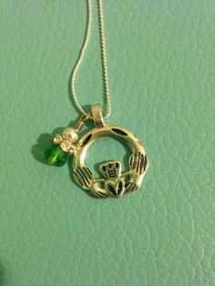 Green Claddagh Necklace by ThingbyWing on Etsy https://www.etsy.com/listing/517041984/green-claddagh-necklace