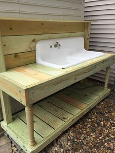 1920s Farm Sink turned in to a garden potting bench. (My hubby is amazing)