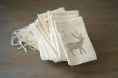 Advent Calendar: Set of 25 3x5 Muslin Bags with Hand-stamped Numbers, Snowflakes, Deer, and Trees.