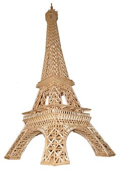 "3D Eiffel Tower construction plans, manual    The tower is 26"" high and 10"" wide.    Step by step instructions on how to build your own 1:500"