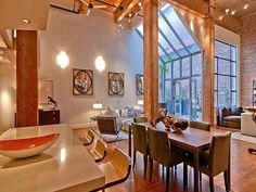*Love the wood wrapped posts & their finish  Urban sexy loft space in San Francisco
