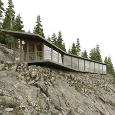 Yoga House. Located high in the mountains, on a cliff, among a pine forest this pavilion is designed for yoga classes both group and individual. #aadzign #thebna #thebestnewarchitects #designboom #architizer #archinect #project #yogahouse #retrit #view #landscapearchitecture #Portugal #FarEast_Primorye Landscape Architecture, Architecture Design, Pine Forest, Pavilion, Design Projects, Yoga Classes, Cabin, Cliff, House Styles