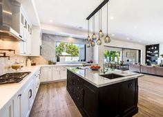 cool lights!  Bella Thorne Just Bought This Los Angeles Home For $2M #refinery29  http://www.refinery29.com/2016/12/133924/bella-thorne-los-angeles-home#slide-2  In the kitchen, you'll find a large entertainment island, custom cabinetry, and even a built-in coffee machine....