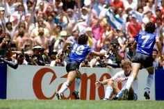 WC '86: Argentina v England - Diego Maradona celebrates as Terry Butcher despairs, Quarter Final, 22 June 1986. (PA Photos)