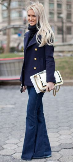 Timeless street style | double breasted navy blazer, jeans, and t-neck. Fab accent clutch.